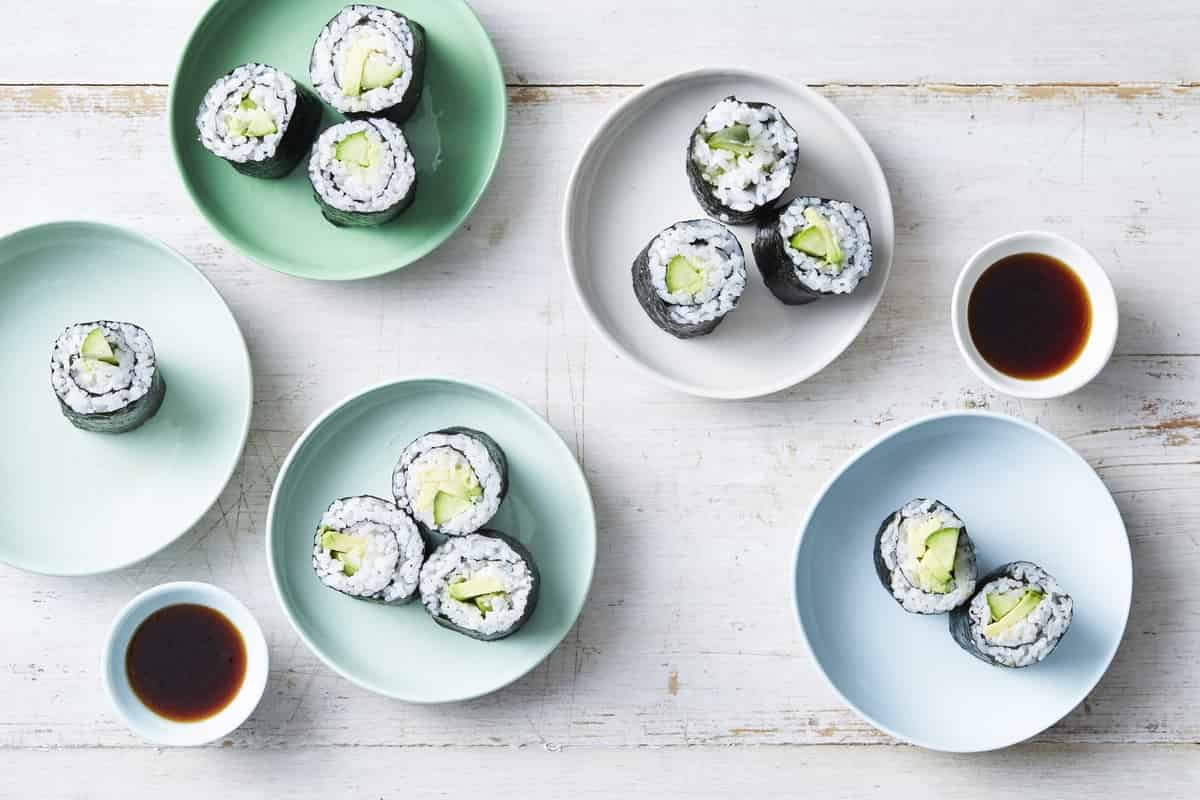 Qukes avocado nori rolls sliced in half and laid out in small plates.